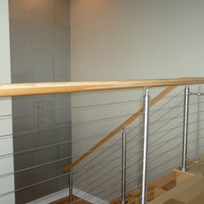 Contemporary Staircase by Vision Investment Group NOLA
