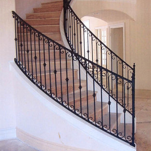 Interior wrought iron stair rails with newel posts, baluster collars, twisted pi