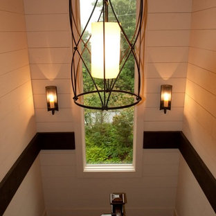 Example of a mid-sized classic wooden u-shaped staircase design in Other with wooden risers
