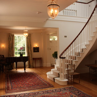 Traditional painted wood staircase in Hampshire with painted wood risers.