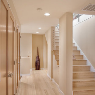 Trendy wooden straight staircase photo in Seattle