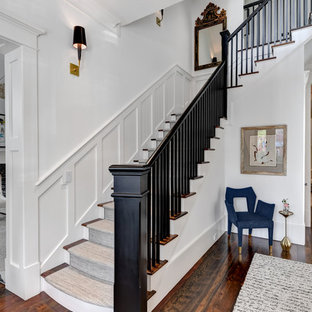 Example of a classic wooden l-shaped wood railing staircase design in Charleston with wooden risers