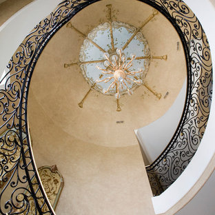 Inspiration for a huge timeless wooden curved staircase remodel in Chicago with painted risers