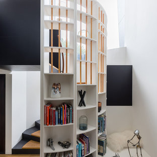 This is an example of a contemporary wood curved staircase in Sydney.