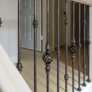 Small tuscan painted l-shaped mixed material railing staircase photo in Other with painted risers