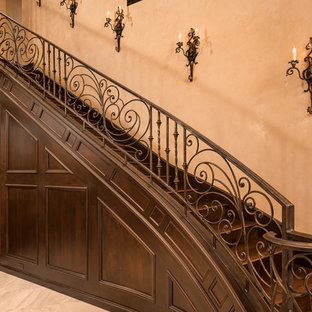 Inspiration for a huge timeless wooden curved metal railing staircase remodel in Phoenix with wooden risers