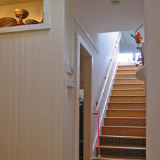 Traditional Staircase by James Hill Architect