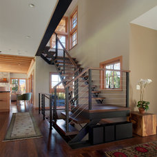 Contemporary Staircase by Gristmill Builders, LTD