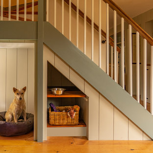 Staircase - mid-sized farmhouse wooden u-shaped wood railing staircase idea in Boston