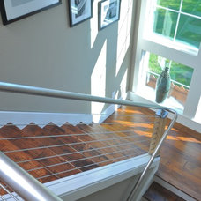 Contemporary Staircase by josh wynne construction