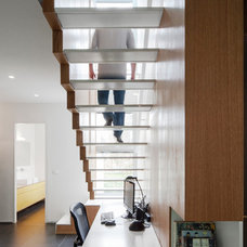 Modern Staircase by arbejazz architects studio ltd.