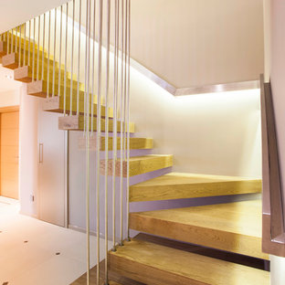 Inspiration for a contemporary floating staircase in Other with open risers.