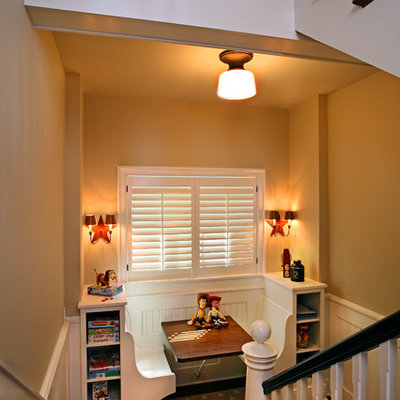Large trendy u-shaped staircase photo in Grand Rapids