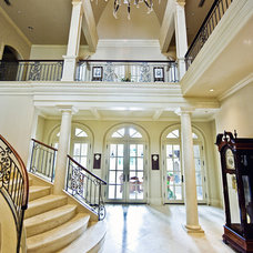 Traditional Staircase by kelley hall