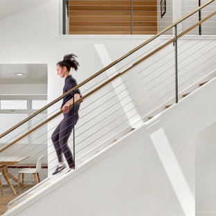 Example of a minimalist wooden straight mixed material railing staircase design in San Francisco with wooden risers