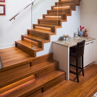 Design ideas for a mid-sized contemporary wood l-shaped staircase in Calgary with wood risers and metal railing.