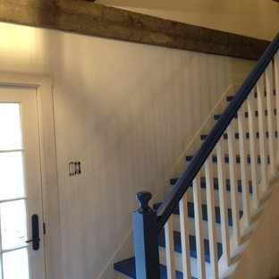 Inspiration for a rustic painted l-shaped staircase remodel in New York with painted risers