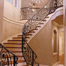 Mediterranean Staircase by Canterbury Custom Homes LLC