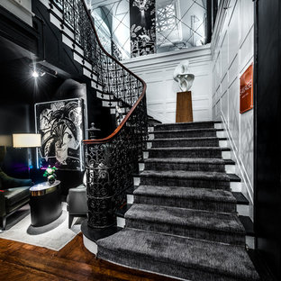 Example of a huge eclectic painted l-shaped metal railing staircase design in New York with painted risers