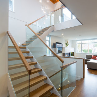 Large trendy wooden l-shaped staircase photo in Vancouver