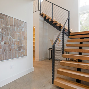 Staircase - mid-sized mid-century modern wooden l-shaped open and metal railing staircase idea in Austin