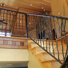 Traditional Staircase by Living Stone Construction, Inc.