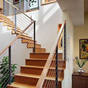 Staircase - contemporary wooden cable railing staircase idea in Raleigh with wooden risers