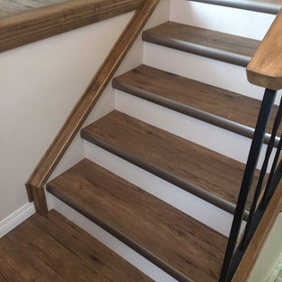 Small rustic straight staircase in Calgary with painted wood risers.