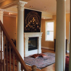 Traditional Staircase by Larry Paul Associates