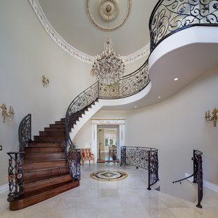 Example of a large tuscan staircase design in Los Angeles