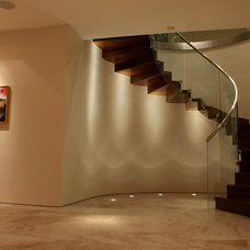 Modern Staircase by Ron Neal Lighting Design