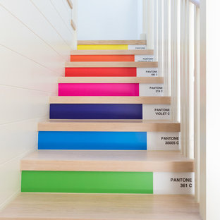 Design ideas for a contemporary wood straight staircase in Channel Islands with painted wood risers.