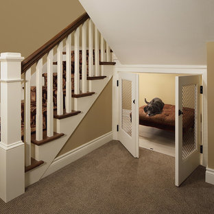 Example of an arts and crafts wooden wood railing staircase design in Milwaukee with painted risers