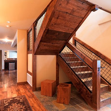 Rustic Staircase by Griggs Custom Homes, Inc