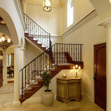 traditional staircase by Lake Country Builders