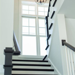 Example of a small classic painted u-shaped staircase design in Milwaukee with painted risers