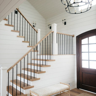 Inspiration for a large cottage wooden u-shaped mixed material railing staircase remodel in Detroit with painted risers
