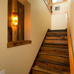 eclectic staircase by Riverland Homes Inc