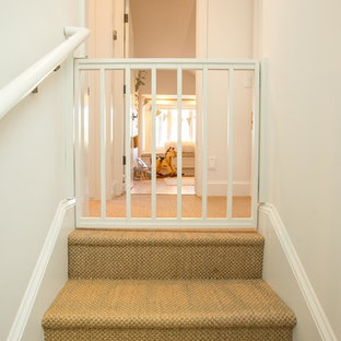 Inspiration for a mid-sized craftsman carpeted u-shaped staircase remodel in Other with carpeted risers