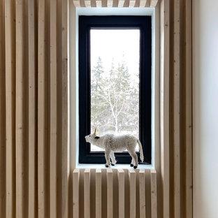 Ejemplo de escalera en L y madera, nórdica, con madera