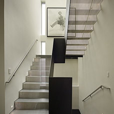 Modern Staircase by NB Design Group, Inc