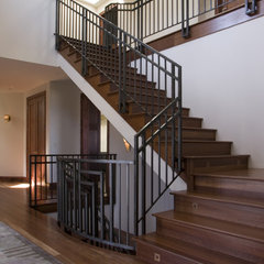 traditional staircase by Simpson Design Group Architects