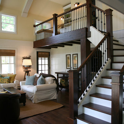 Inspiration for a mid-sized timeless wooden l-shaped metal railing staircase remodel in Milwaukee with painted risers
