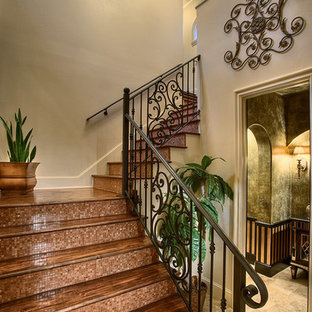 Staircase - large painted l-shaped staircase idea in Austin with tile risers