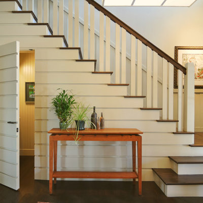 Inspiration for a timeless wooden l-shaped staircase remodel in Other
