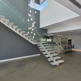 Staircase - mid-sized modern marble l-shaped open and glass railing staircase idea in Los Angeles