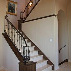 Mediterranean Staircase by Landmark Builders