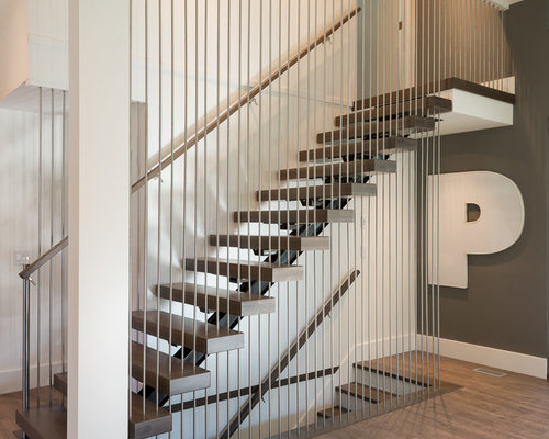 The Spiral Staircase History Features And Designs together with Axxys Rail In A Box Oak Brushed Nickel Set furthermore Metal Staircase additionally Dark Wood Stairs additionally Gallery Stairs Railings. on wood and metal railings for stairs
