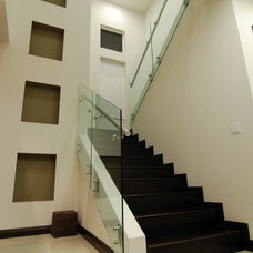Contemporary Staircase by Home & Commercial Designs