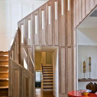 Example of a large transitional wooden u-shaped staircase design in Chicago with wooden risers
